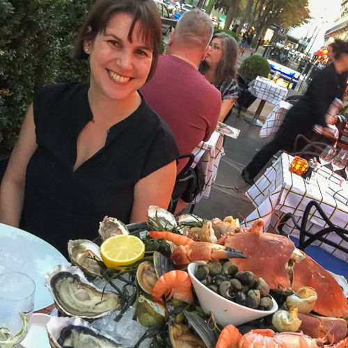 Nora Maynard in Paris with seafood tower.