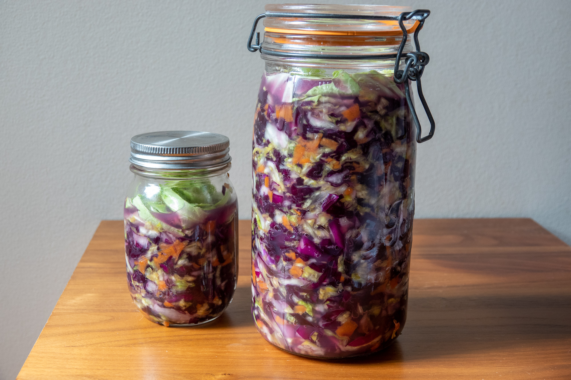 Sauerkraut in jars on table.